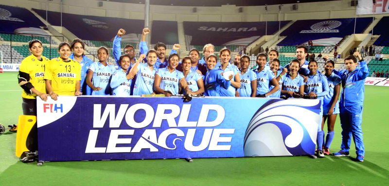 Indian players celebrate after winning the final match of FIH Hockey World League Round 2 (Women) against Poland  at Major Dhyan Chand National Stadium in New Delhi on March 15, 2015 ...