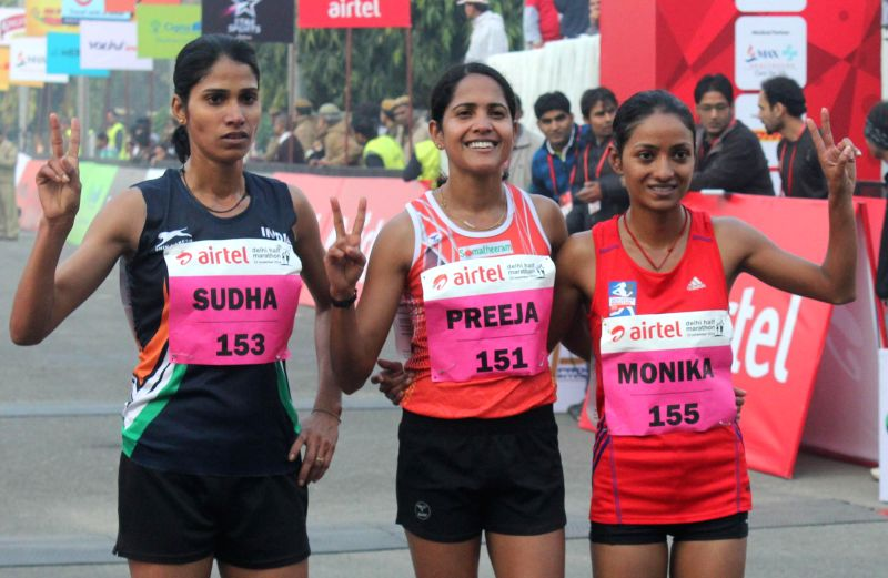 New Delhi Indian runners Preeja Sreedharan, Monika and Sudha the winner, first runner-up and the second runner up of Airtel Delhi Half Marathon at Jawaharlal Nehru Stadium in New Delhi on Nov 23, ...