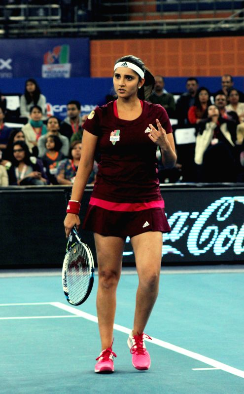 Indian tennis players Sania Mirza during an IPTL match in New Delhi on Dec 7, 2014.