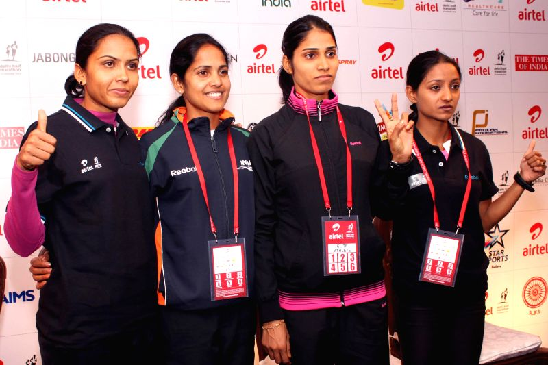 Indian women athletes during the Meet and Greet session of the Airtel Delhi Half Marathon in New Delhi on Nov 22, 2014.