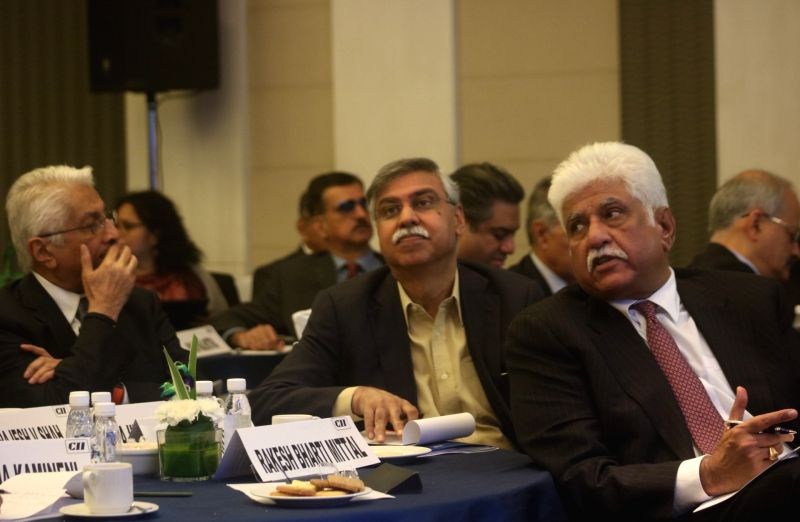 : New Delhi: Industrialists Sunil Kant Munjal, Rakesh Bharti Mittal with others at CII headquarter watching Union Budget presented by Union Finance Minister Arun Jaitley in New Delhi on Feb. 1, ...