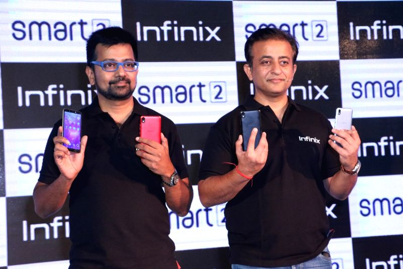 ": New Delhi: Infinix Vice President (Marketing) and Chief Marketing Officer Tathagat Jena and CEO Anish Kapoor at the launch of Infinix ""SMART 2"" smartphone, in New Delhi on Aug 2, 2018. (Photo: ..."