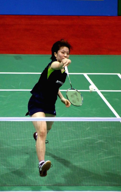 Japanese badminton player Yui Hashimoto returns a shot to Saina Nehwal of India during a women`s singles match of Yonex Sunrise Indian Open Badminton Championship in New Delhi on March 28, ...