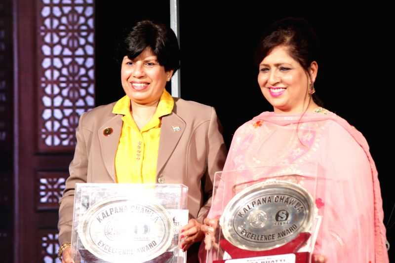 New Delhi:Jaspal Bhatti's widow Savita Bhatti and former Indian marathon runner Sunita Godara during a programme organised to confer Kalpan Chawal Excellence Award 2015 at the India Islamic Cultural ...