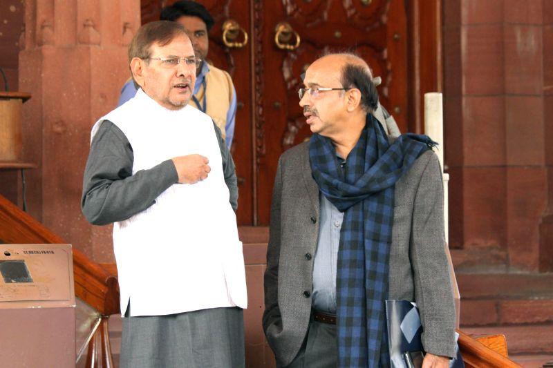 JD(U) chief Sharad Yadav and BJP leader Vijay Goel at the Parliament premises in New Delhi, on Nov 28, 2014. - Sharad Yadav