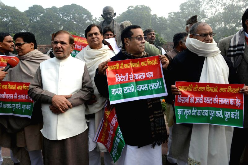 JD (U) chief Sharad Yadav and others stage a protest against Narendra Modi led Union Government at the Parliament House, in New Delhi on Dec 22,2014. - Sharad Yadav