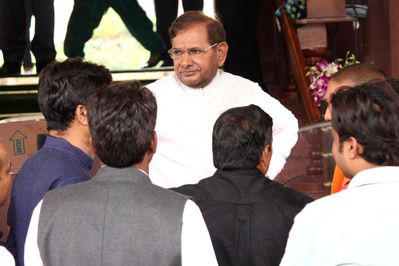 JD(U) chief Sharad Yadav and others at the Parliament on the second day of the budget session in New Delhi, on Feb 24, 2015. - Sharad Yadav