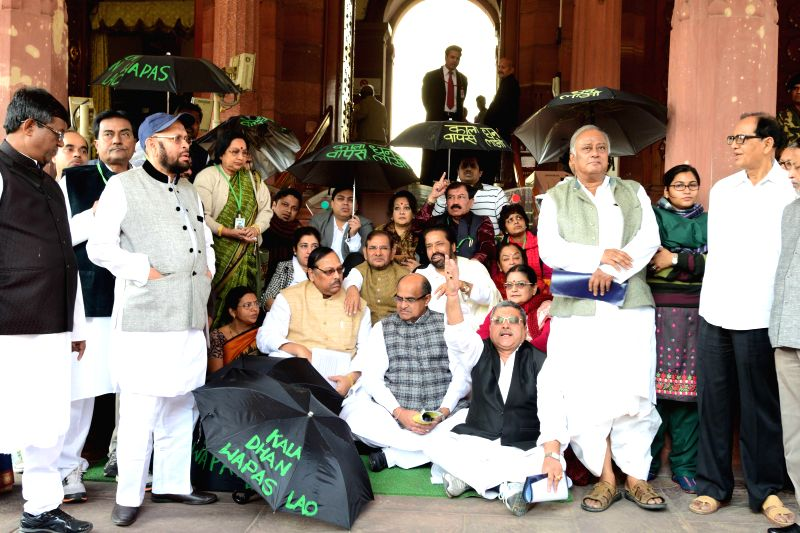 JD(U) chief Sharad Yadav and party MP K C Tyagi join Trinamool Congress MPs demonstrating against the issue of black money in the Parliament premises on Nov 25, 2014. - Sharad Yadav