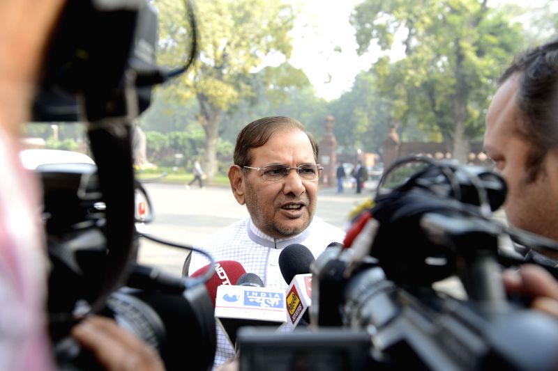 JD (U) chief Sharad Yadav talks to press at the Parliament premises in New Delhi, on Dec 17, 2014. - Sharad Yadav