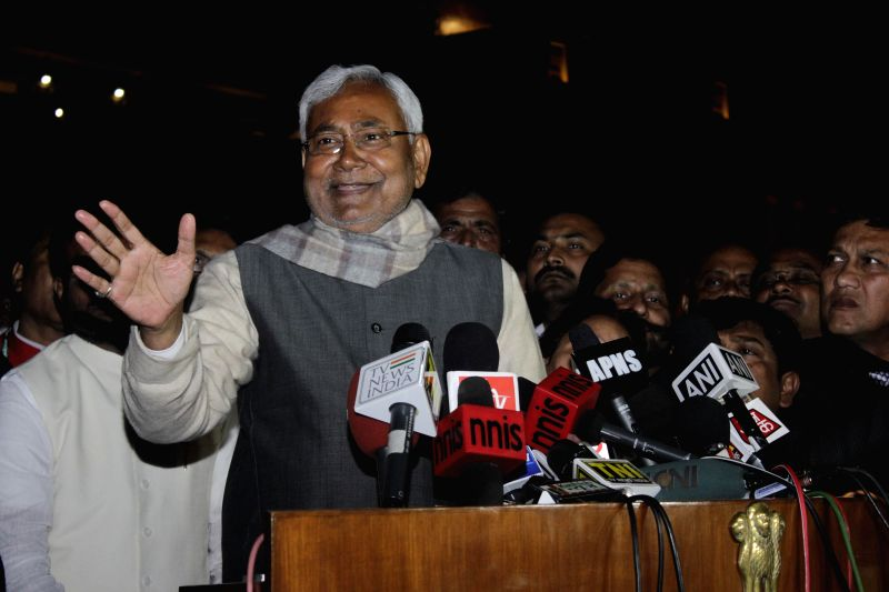 JD(U) leader Nitish Kumar addresses press after meeting President Pranab Mukherjee at Rashtrapati Bhawan in New Delhi, on Feb 11, 2015. - Nitish Kumar and Pranab Mukherjee