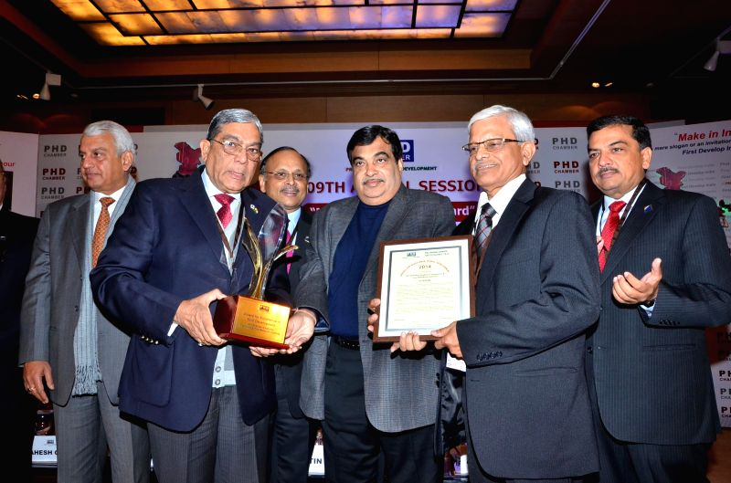 JK Tyre President and Director Arun K Bajoria, Union Minister for Road Transport and Highways Nitin Gadkari and Hari Shankar Singhania Elastomer and Tyre Research Institute (HASETRI) ...