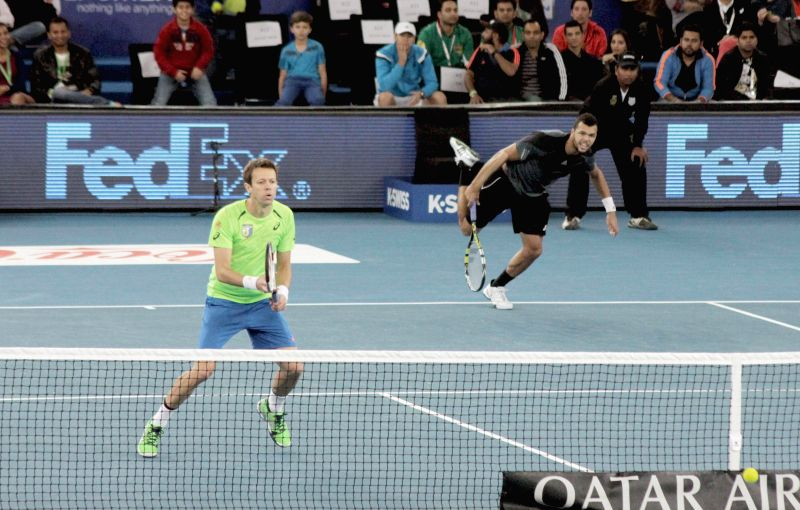 Jo-Wilfried Tsonga and Daniel Nestor of Manila Mavericks in action against Nenad Zimonjic and Novak Djokovic of UAE Royals during a mens' doubles IPTL match at Indira Gandhi Indoor Arena ..