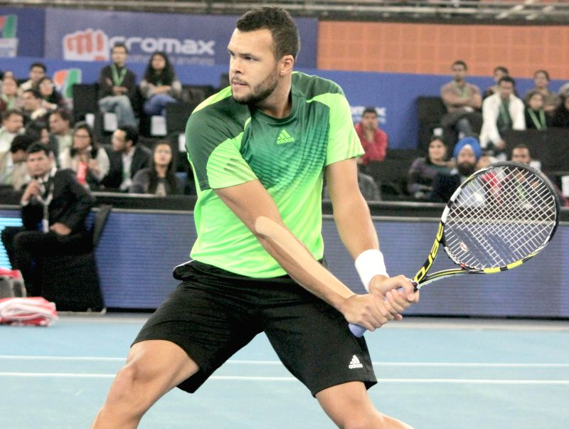 Jo-Wilfried Tsonga of Manila Mavericks in action against Marin Cilic of UAE Royals t Indira Gandhi Indoor Arena in New Delhi, on Dec 7, 2014. Cilic won. Score: 5-6.