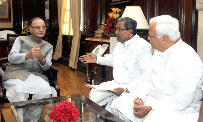 Karnataka Chief Minister Siddaramaiah calls on the Union Minister for Finance, Corporate Affairs and Information and Broadcasting, Arun Jaitley, in New Delhi on June 10, 2015.
