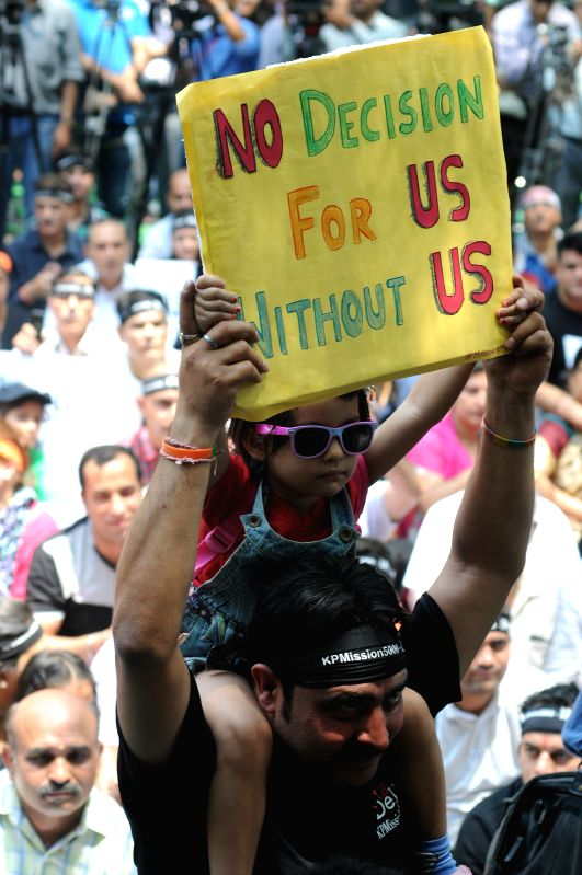 Kashmiri Pandits stage a demonstration to demand their participation in decisions regarding their return to the valley, at Jantar Mantar in New Delhi, on May 3, 2015.