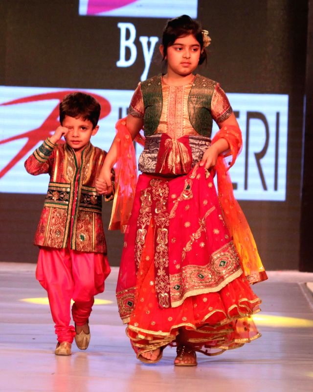 Kids walk on the ramp for designer Ritu Beri`s show at India Kids Fashion Week 2015, in New Delhi on March 01, 2015.