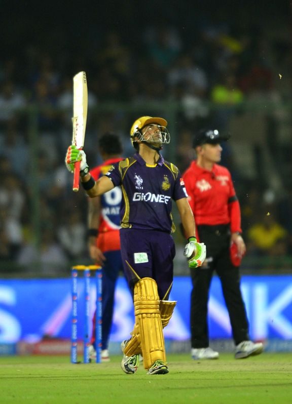 Kolkata Knight Riders captain Gautam Gambhir celebrates his half century during an IPL-2015 match between Delhi Daredevils and Kolkata Knight Riders at Feroz Shah Kotla stadium, in New ... - Gautam Gambhir and Feroz Shah Kotla