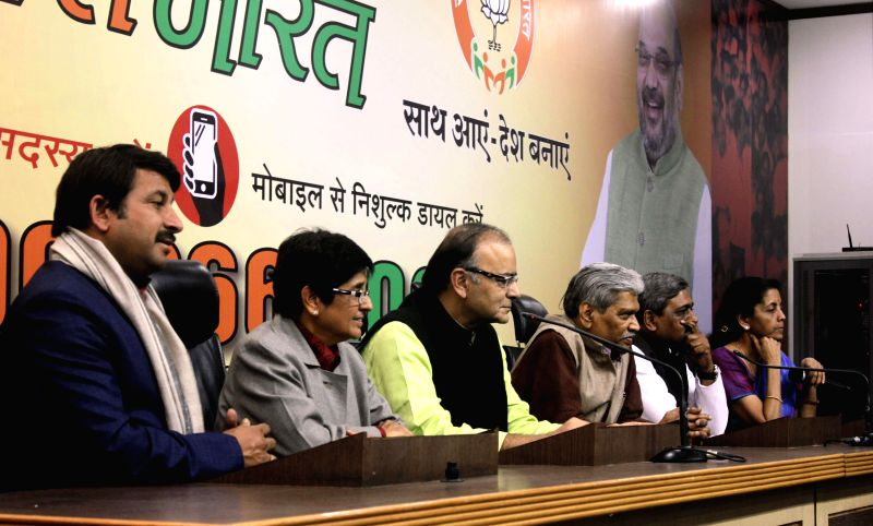 (L-R) BJP MP Manoj Tiwari, BJP's Delhi chief ministerial candidate Kiran Bedi, Union Minister for Finance, Corporate Affairs, and Information and Broadcasting Arun Jaitley, Delhi in-charge - Kiran Bedi, Arun Jaitley and Satish Upadhyay