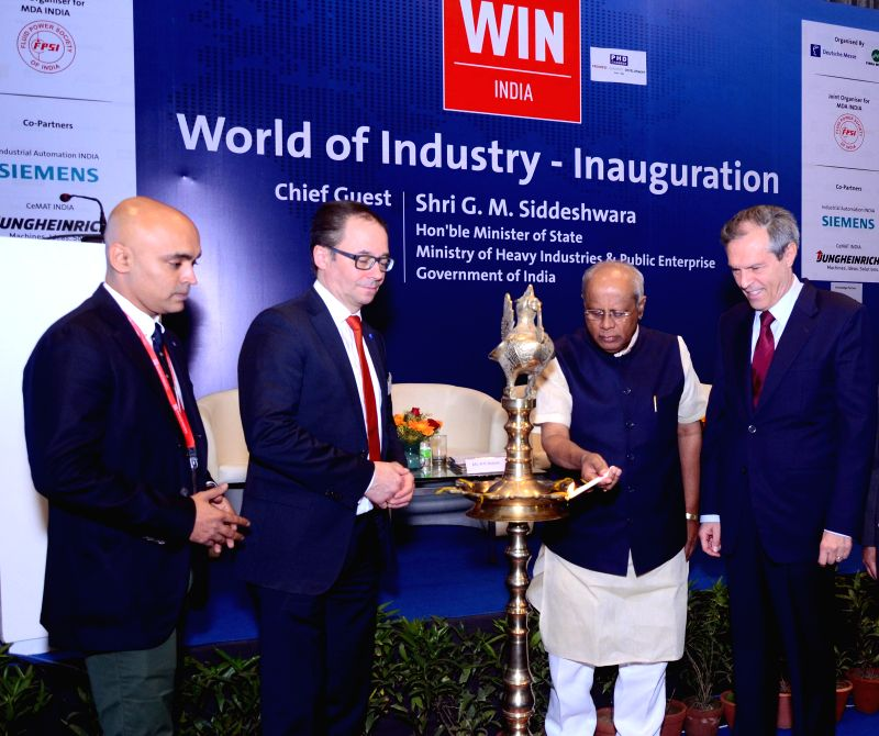 (L-R) Mehul Shah MD of HMFI, Wolfgang Pech the vice president of Doutshe messe, Minister of State for Heavy Industries and Public Enterprises G M Siddeshwara, and Michael Steiner the ... - Mehul Shah M