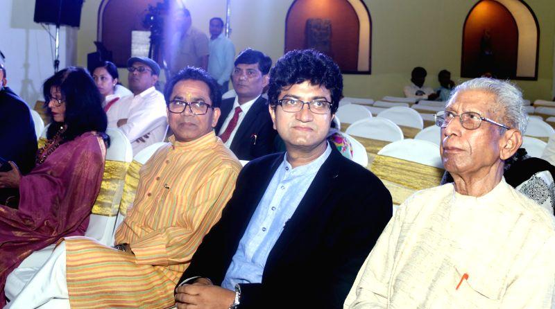 (L to R) Author Ashok Chakradhar, writer-lyricist Prasoon Joshi and author Namvar Singh during the launch of author Rama Pandey`s books Guhaar, Giraftaar and a documentary `Kalam Se Camera ... - Prasoon Joshi, Namvar Singh and Pandey