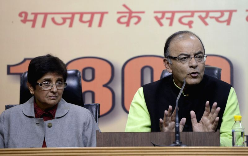 (L to R) BJP`s Delhi chief ministerial candidate Kiran Bedi and Union Minister for Finance, Corporate Affairs, and Information and Broadcasting Arun Jaitley during a BJP press conference .. - Kiran Bedi and Arun Jaitley
