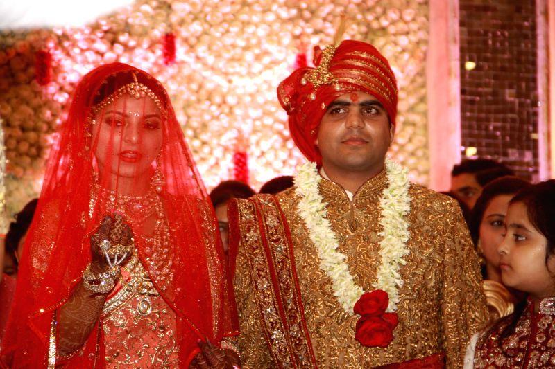 Lalu Yadav's daughter Raj Lakshmi and Samajwadi Party supremo Mulayam Singh Yadav's grandnephew and MP Tej Pratap Yadav during their wedding ceremony in New Delhi on Feb 26, 2015. - Lalu Yadav, Mulayam Singh Yadav and Tej Pratap Yadav