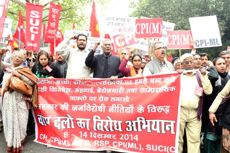 Left party activists led by CPI leader D. Raja and CPI(M) leader Nilotpal Basu participating in a march to Parliament in protest against the anti-people policies of the Union Government in - Nilotpal Basu