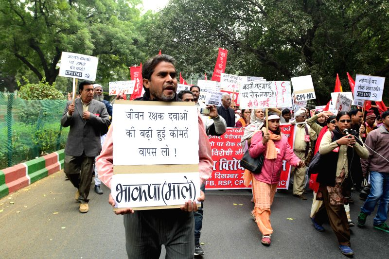 Left party activists participating in a march to Parliament in protest against the anti-people policies of the Union Government in New Delhi on Dec. 13, 2014.
