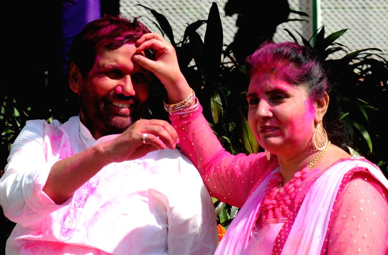 LJP chief and Union Minister for Consumer Affairs, Food and Public Distribution Ramvilas Paswan celebrates Holi in New Delhi, on March 6, 2015.