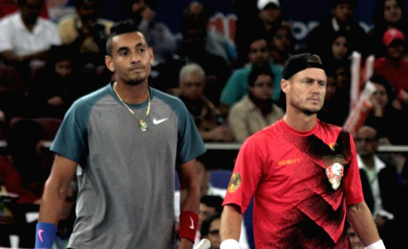 Lleyton Hewitt and Nick Kyrgios of Singapore Slammers during an IPTL men's doubles match against Indian Aces players Roger Federer and Rohan Bopanna at Indira Gandhi Indoor Arena in New ... - Rohan Bopanna