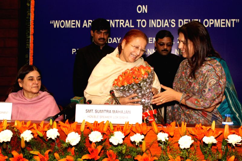 Lok Sabha Speaker Sumitra Mahajan, Union Minister for Women and Child Development Maneka Gandhi and BJP MP Meenakshi Lekhi during a seminar on `Women are Central to India's Development` in - Sumitra Mahajan and Development Maneka Gandhi
