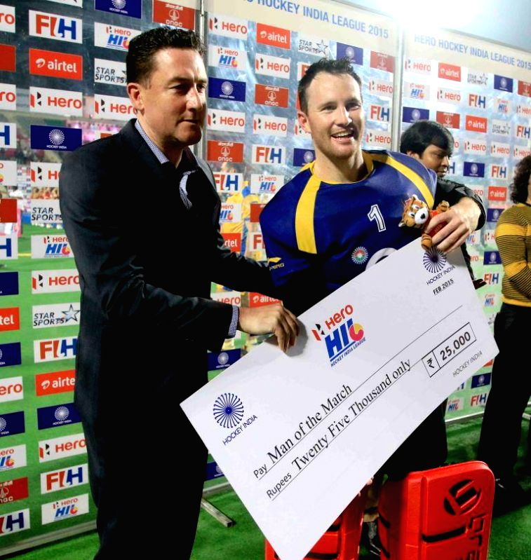 Lovell Tyler of Ranchi Rays receives cheque for Man of the Match at the Major Dhyan Chand National Stadium in New Delhi, on Feb 22, 2015. Ranchi Rays won the Hero Hockey India League (HIL) ...