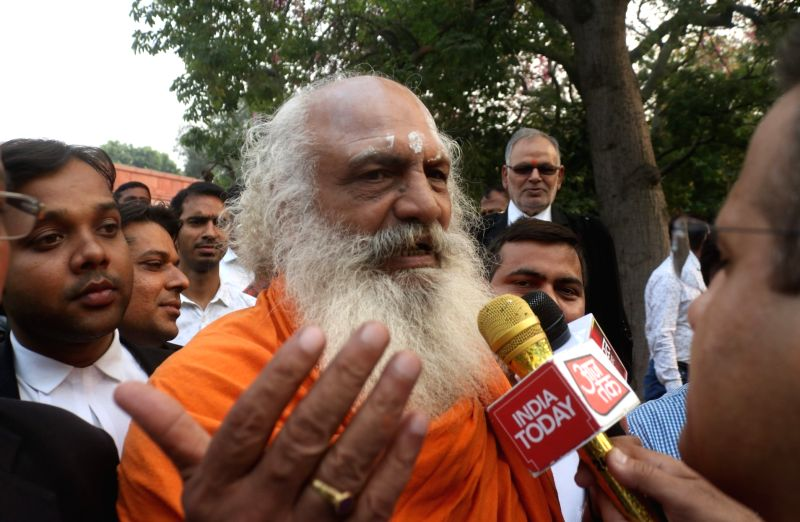 New Delhi: Mahant Dharam Das of the Nirwani Akhara, one of the litigants in the Ram Janmabhoomi-Babri Masjid dispute, talks to the media persons outside the Supreme Court on the final day of hearing in the case, in New Delhi on Oct 16, 2019. (Photo: