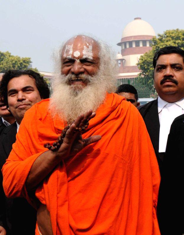 :New Delhi: Mahant Dharam Dass of Nirwani Akhara, a litigant in the Babri Masjid-Ram Janambhoomi title suit, talks to the media outside the Supreme Court in New Delhi on Oct 29, 2018. The apex ...