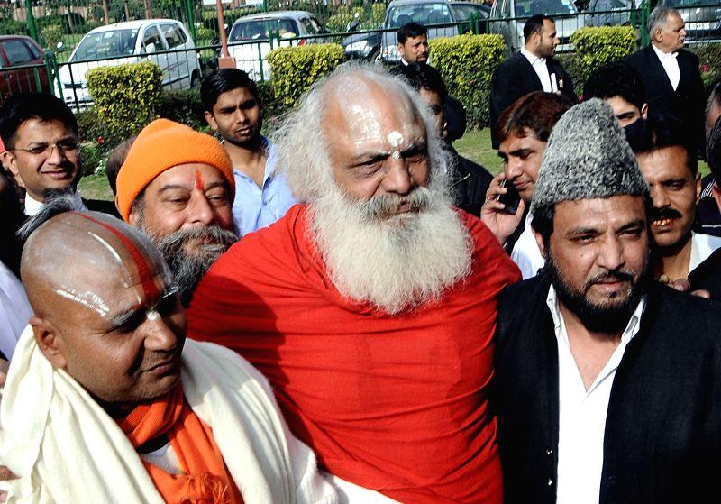 New Delhi: Mahant Ramdas, Mahant Dharam Das and self-proclaimed descendant of Mughal emperor Bahadur Shah Zafar, Prince Yakub Habeebuddin Tucy outside the Supreme Court after a hearing on the Babri Masjid- Ram Janmabhoomi dispute, in New Delhi on Feb