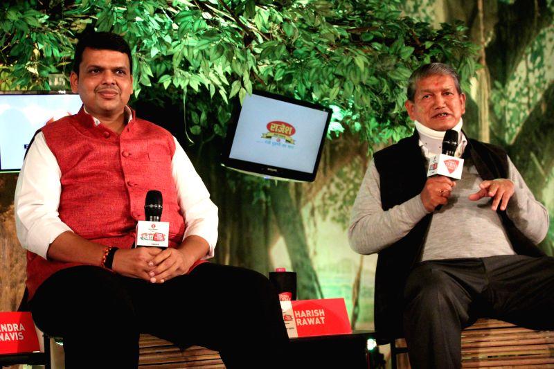 Maharashtra Chief Minister Devendra Fadnavis with Uttarakhand Chief Minister Harish Rawat during a programme organised by Aaj Tak news channel in New Delhi, on Dec 13, 2014. - Devendra Fadnavis