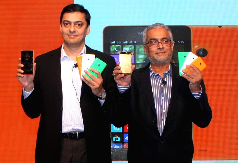 New Delhi:Managing Director of Nokia India Ajey Mehta and Chairman of Microsoft India Bhaskar Pramanik at the launch of a Nokia smartphone in New Delhi, on Nov 26, 2014. - Ajey Mehta