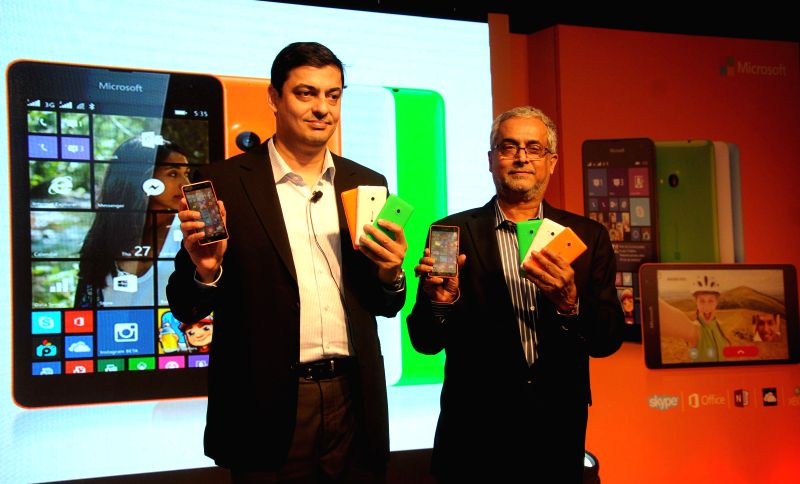 Managing Director of Nokia India Ajey Mehta and Chairman of Microsoft India Bhaskar Pramanik at the launch of Lumia 535 - Microsoft's first Lumia phone without Nokia branding in India, in . - Ajey Mehta