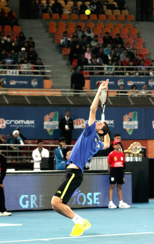 Marin Cilic of UAE Royals in action against Jo-Wilfried Tsonga of Manila Mavericks at Indira Gandhi Indoor Arena in New Delhi, on Dec 7, 2014. Cilic won. Score: 5-6.
