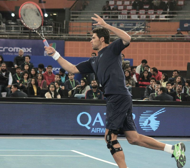 Mark Philippoussis of Manila Mavericks in action against Goran Ivanisevic of UAE Royals during an IPTL men's singles match at Indira Gandhi Indoor Arena in New Delhi, on Dec 7, 2014. ...