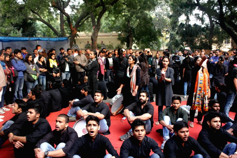 Members of Asmita Theatre group stage a street play during a demonstration to press for the rights of acid attack victims at Jantar Mantar in New Delhi, on Dec 12, 2014.