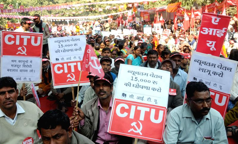 Members of CITU raise slogans during a protest at Jantar Mantar against the central government's anti- labour and anti-people policies in New Delhi, on Dec 5, 2014.