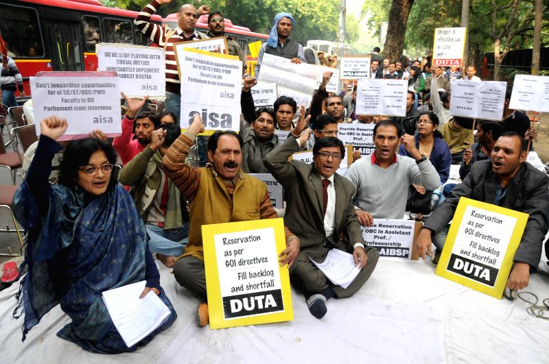 Members of Delhi University Teachers Association (DUTA) stage a demonstration to demand reservations  as per the Government Of India directives to fill backlogs and shortfall in the ...