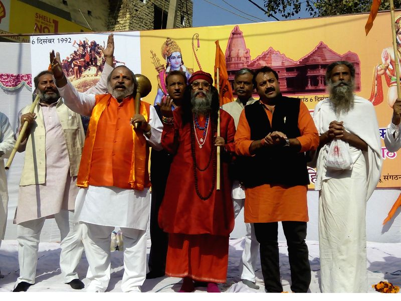 Members of United Hindu Front celebrate `Vijay Diwas` on the 22nd anniversary of Babri Masjid demolition in New Delhi on Dec. 6, 2014.