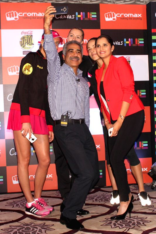 Micromax CEO Vineet Taneja with tennis players Sania Mirza, Ana Ivanovic, Kristina Mladenovic and Daniela Hantuchova at the launch of the `Canvas Selfie` in New Delhi on Dec 8, 2014.