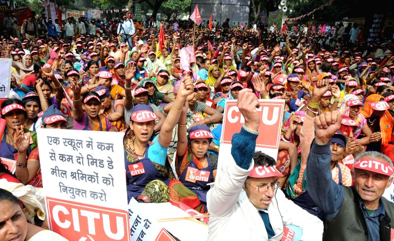 Mid-Day meal workers affiliated to CITU stage a demonstration at Jantar Mantar to press for their demands in New Delhi, on Feb 24, 2015.