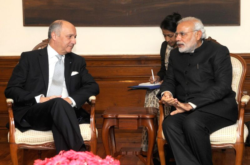 Minister of Foreign Affairs and International Development of France, Laurent Fabius calls on the Prime Minister Narendra Modi, in New Delhi on Feb 5, 2015. - Narendra Modi