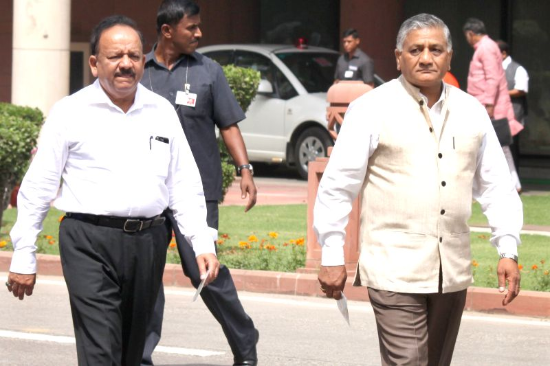 Minister of State Gen.VK Singh and Union Minister for Science and Technology and Earth Sciences Harsh Vardhan at Parliament house on April 21, 2015.