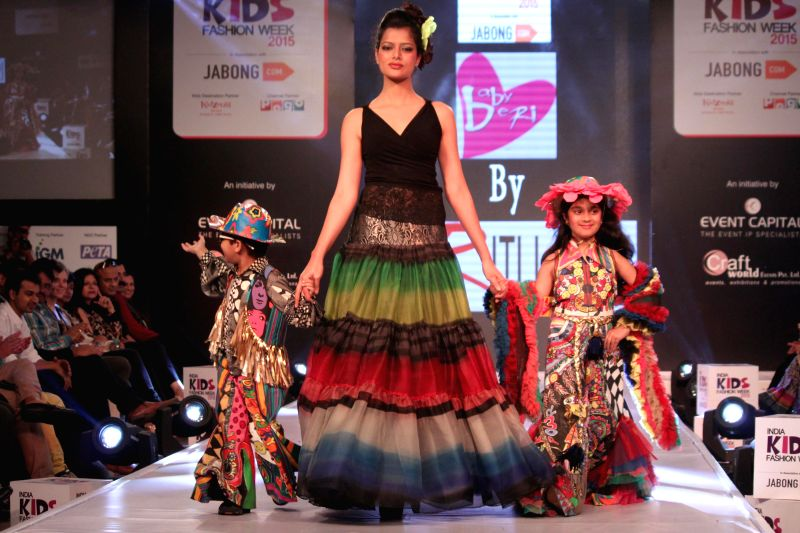 Model walk on the ramp with Kids for designer Ritu Beri`s show at India Kids Fashion Week 2015, in New Delhi on March 01, 2015.