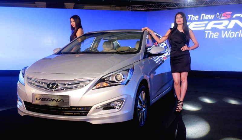 Models at the launch of the New 4S Fluidic Verna in New Delhi on Feb 18, 2015.